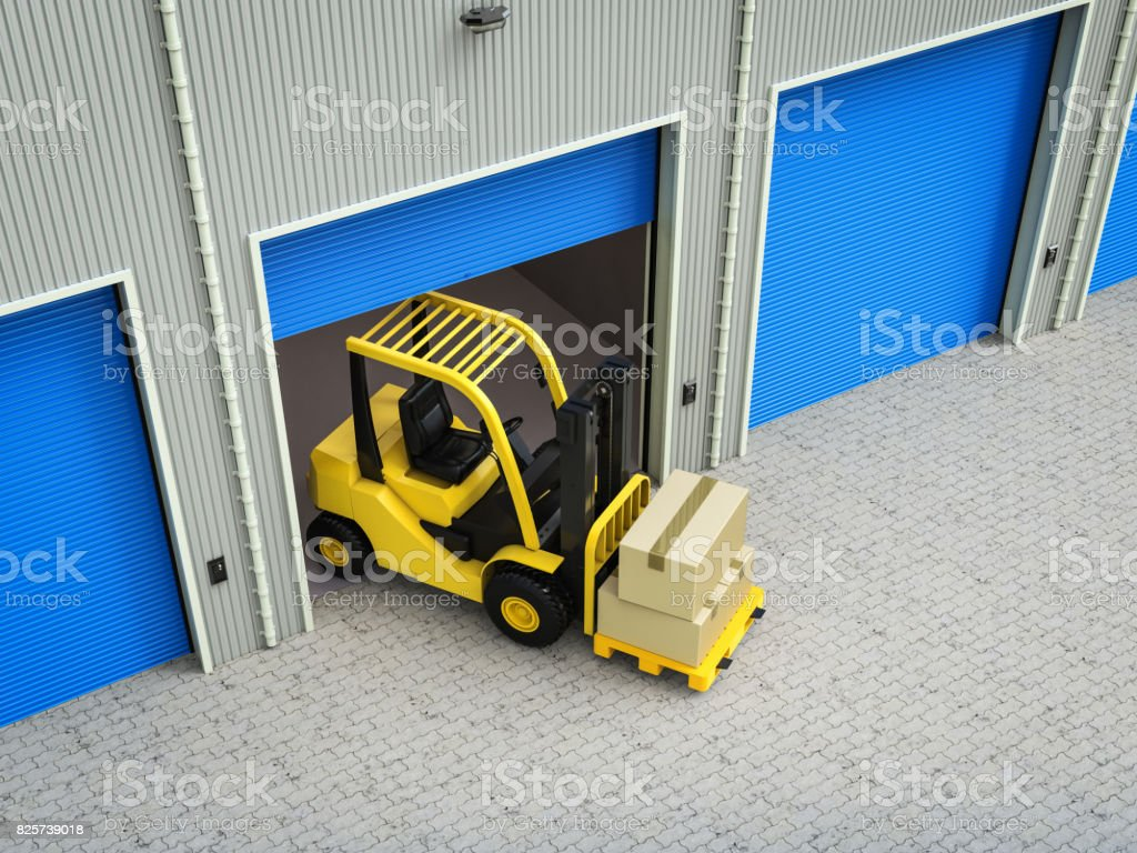 forklift truck with boxes in warehouse stock photo