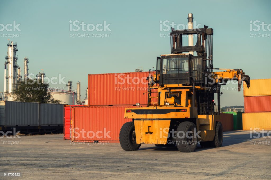 Forklift unloading and container stack in yard cargo shipping. stock photo