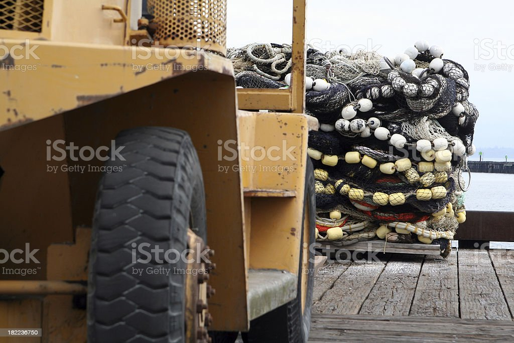 Forklifting the Fish Nets royalty-free stock photo