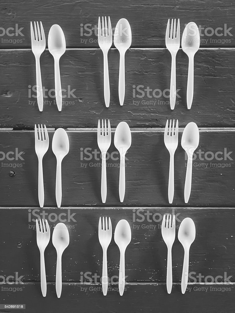 forks and spoons with wood background stock photo