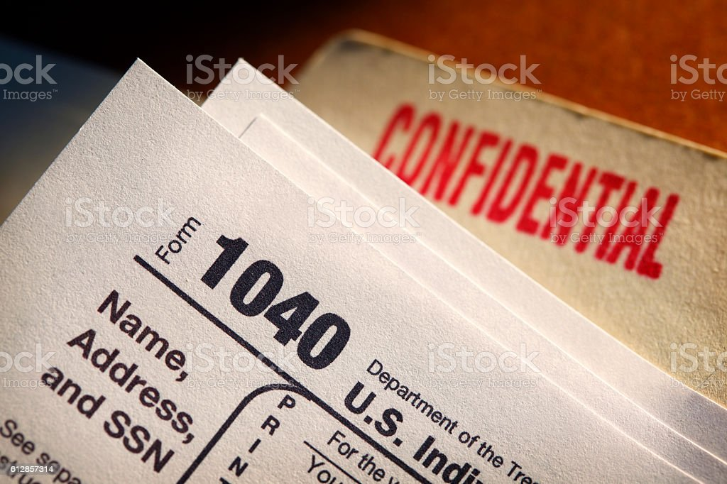 IRS Form 1040 On Top Of A Confidential File Folder stock photo