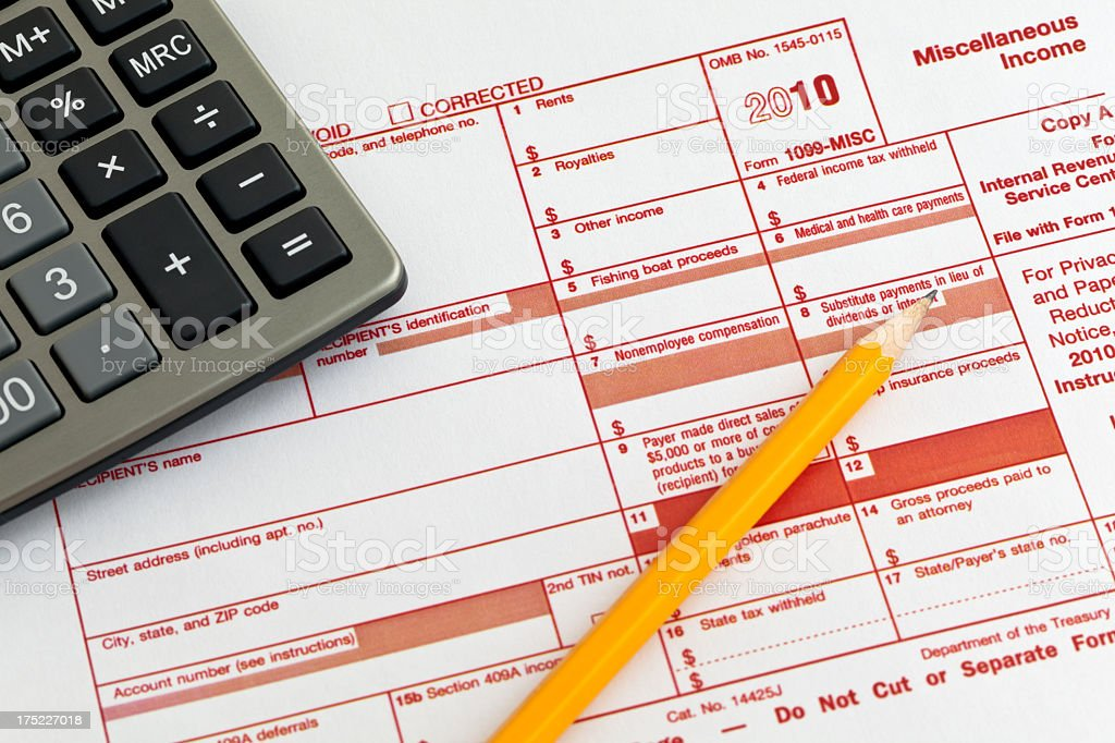 Form 1099-MISC for 2010 with calculator and pencil on it royalty-free stock photo