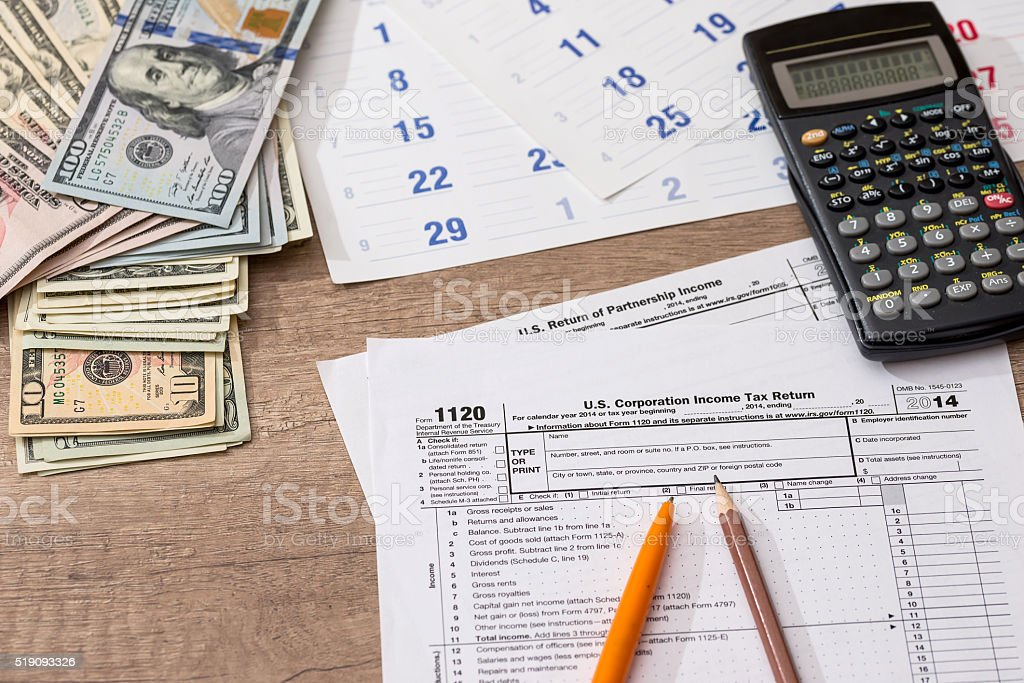 Form 1120 Corporate Tax Return with Calendar, Calculator and Pen stock photo