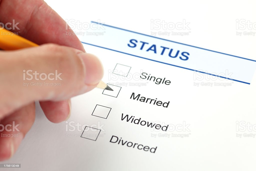 A form filling out a person's marital status stock photo