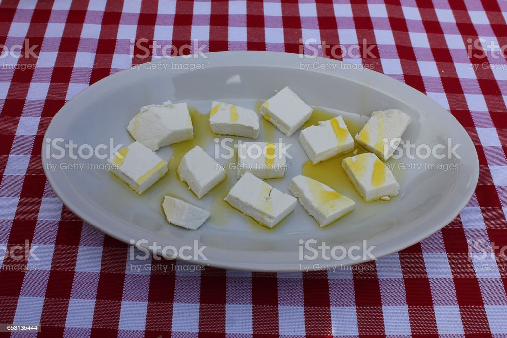 form of cheese with olive oil in a dish stock photo