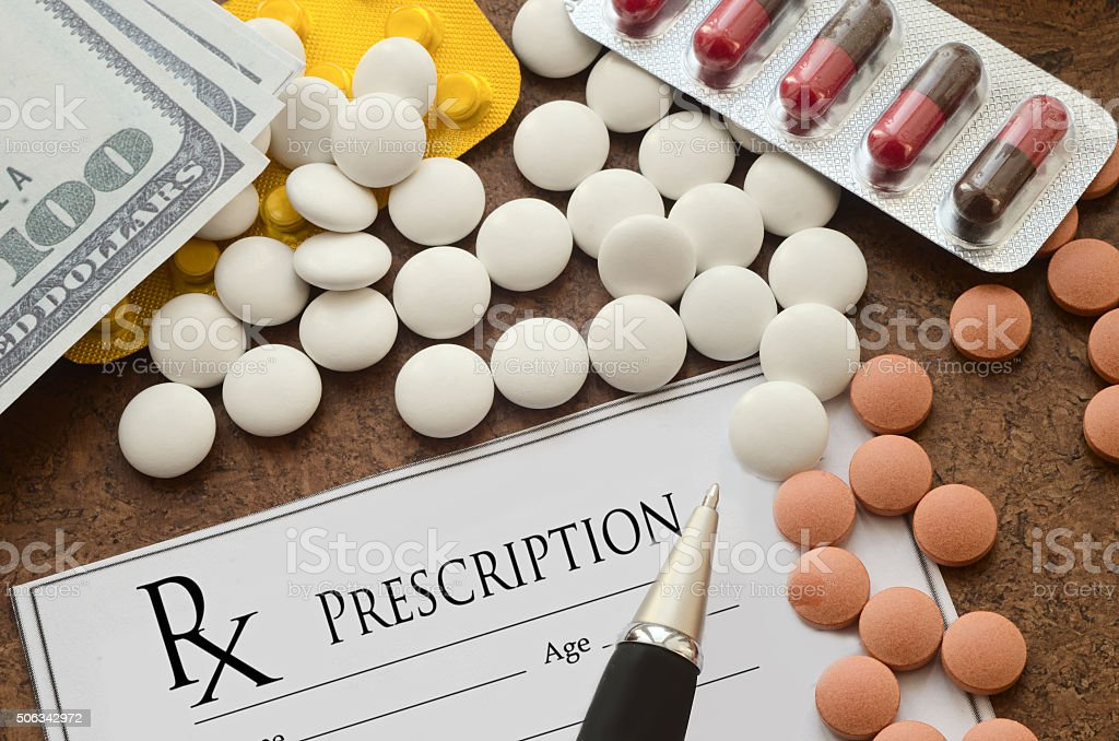 Form of prescription medicine, pills and money stock photo