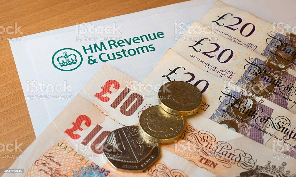 HMRC form with money stock photo