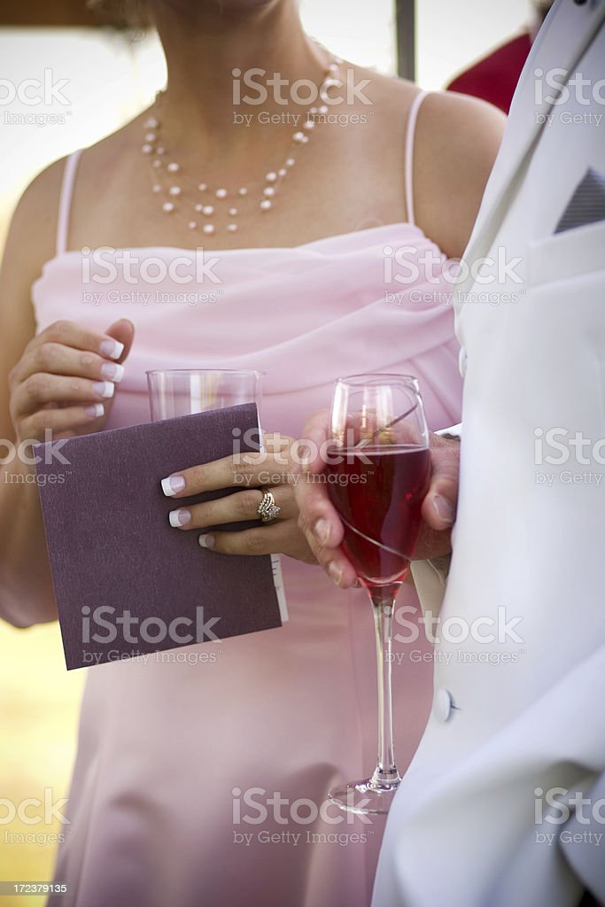Formal Dressed Man and Woman Standing Holding Wine Glasses stock photo