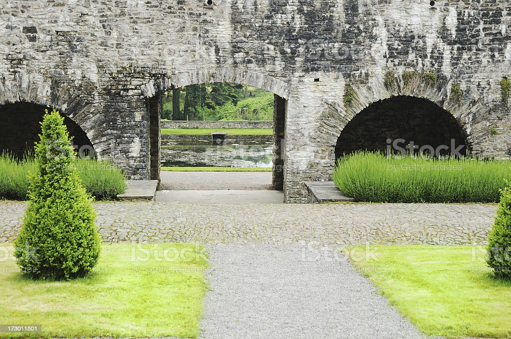 formal garden, archway and water stock photo