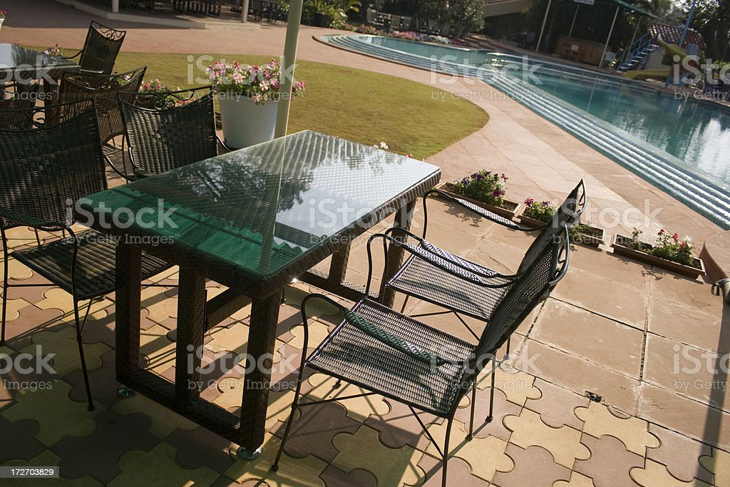 Formal Garden Chair Restaurant with Swimming Pool royalty-free stock photo