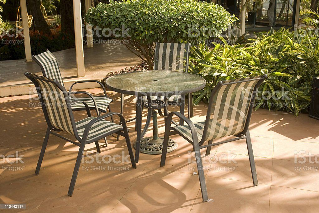 Formal Garden with Round Table and Chairs royalty-free stock photo