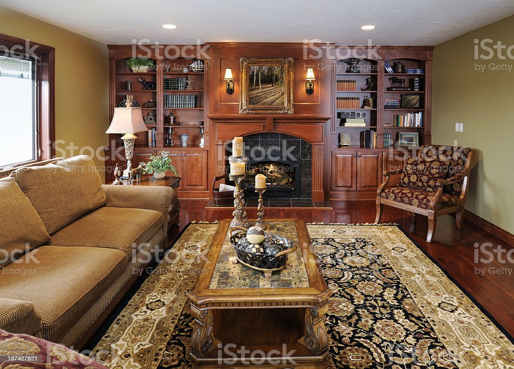 Formal Living Room Home Interior, Hardwood Cabinetry, Fireplace, Persian Rug royalty-free stock photo