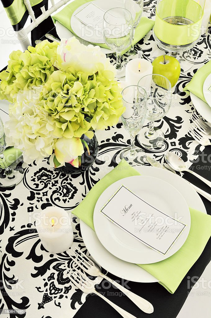 Formal Place Setting, Candles, Flower Arrangement On DeMasque Table Cloth stock photo