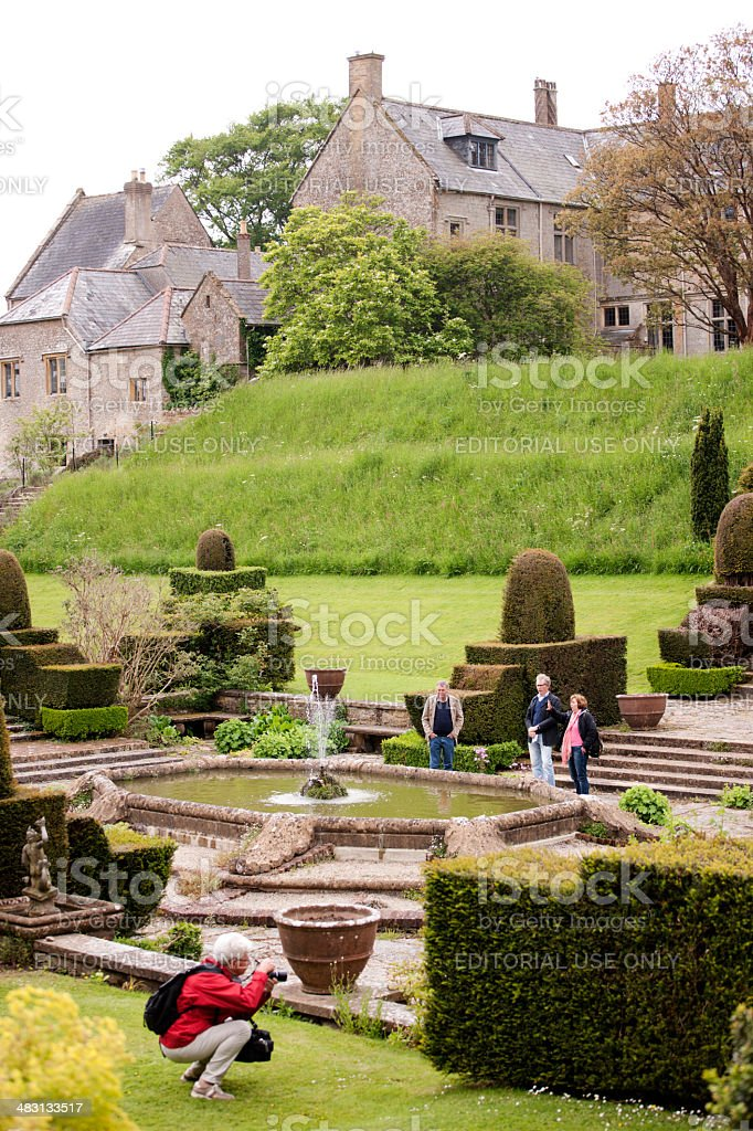 Formal pond with topiary garden stock photo