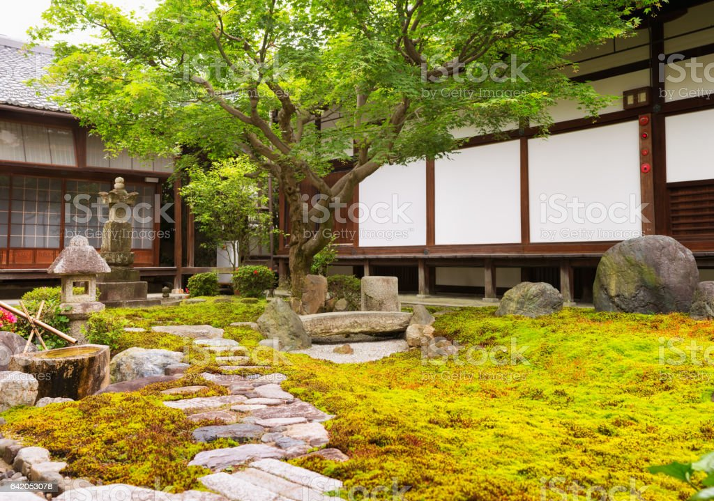 Formal rock and moss garden at Japanese Buddhist temple stock photo