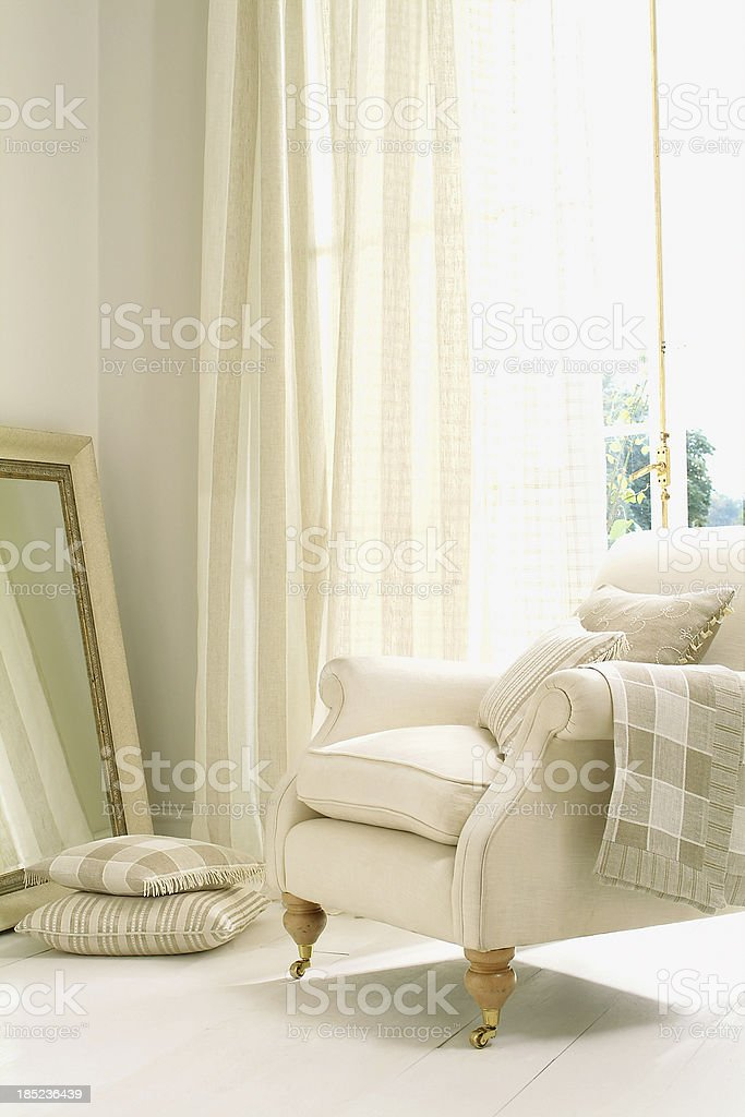 Formal white chair next to window with curtain royalty-free stock photo