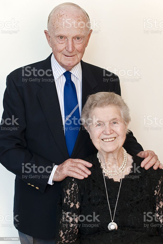 Formally dressed affectionate couple in their eighties royalty-free stock photo