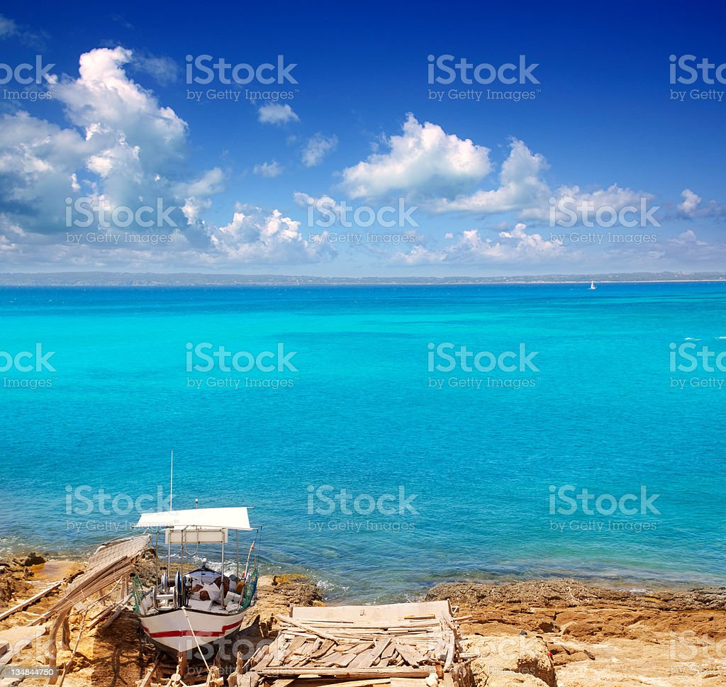 Formentera Es Ram beach with traditional boat stock photo