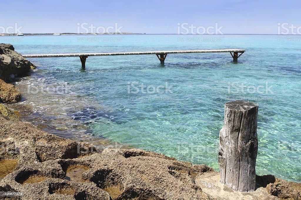 Formentera Illetes turquoise sea wooden pier royalty-free stock photo