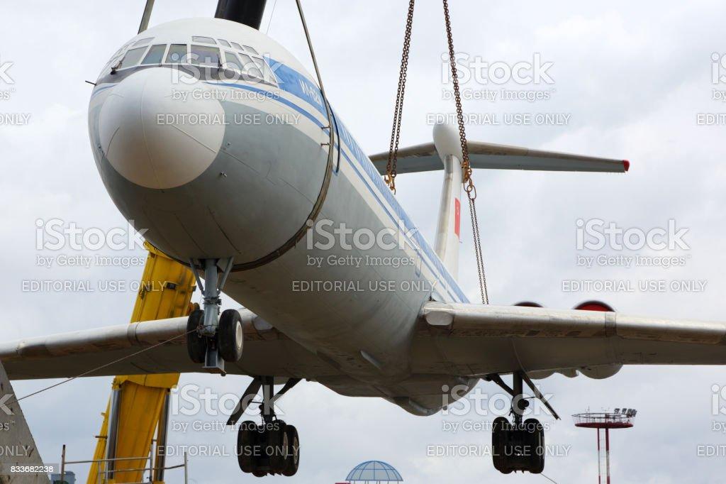 Former Aeroflot Ilyushin IL-62M RA-86492 putting on a plinth with kranes at Sheremetyevo international airport. stock photo