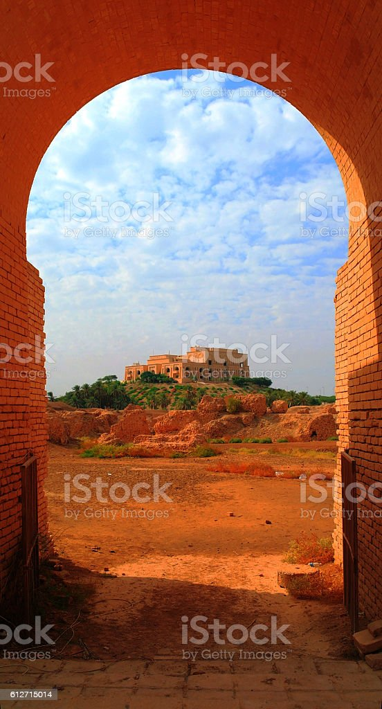 Former Saddam Hussein Palace, view through Babylonian ruins arch , Iraq stock photo
