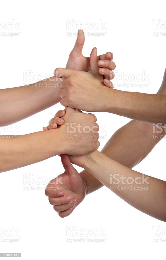 Forming a team. Fists in chain. royalty-free stock photo