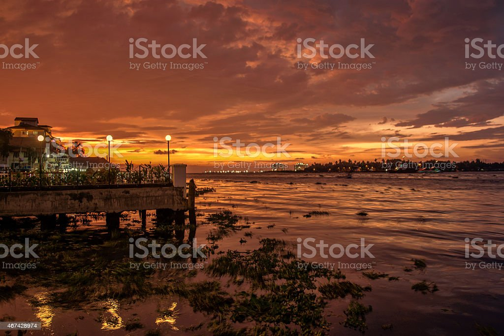Fort Kochi shoreline at sunset stock photo