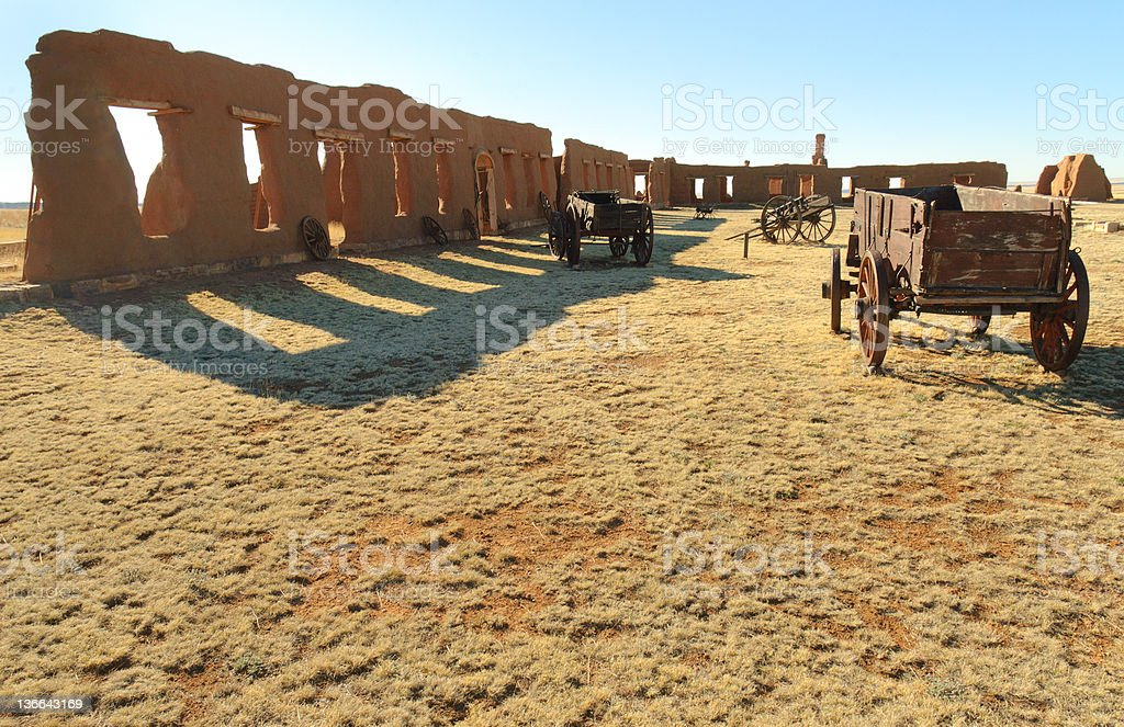 Fort Union, adobe ruins and wooden wagons stock photo