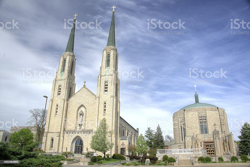 Fort Wayne Cathedral against a cloudy blue sky stock photo