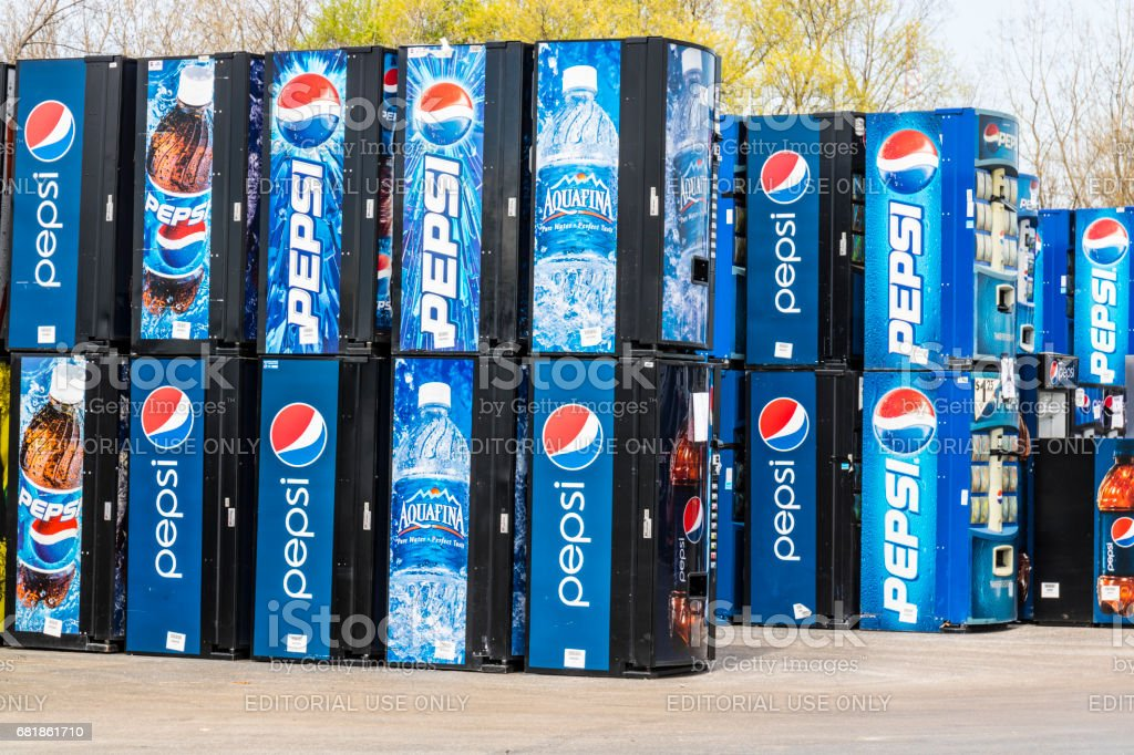 Fort Wayne, Indiana - Circa April 2017: Pepsi and PepsiCo Vending Machines Awaiting Repair. Pepsi is one of the largest beverage producers in the world IV stock photo