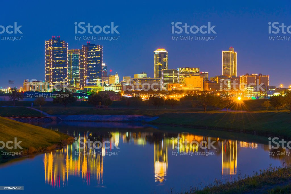 Fort Worth skyline at dusk with the Trinity River reflection stock photo