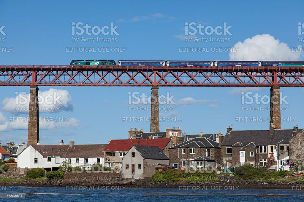 Forth Rail Bridge with a locomotive hauled train. stock photo