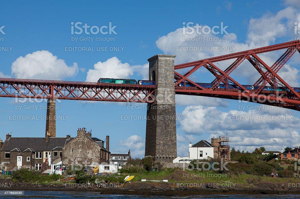 Forth Rail Bridge with a locomotive hauled train stock photo