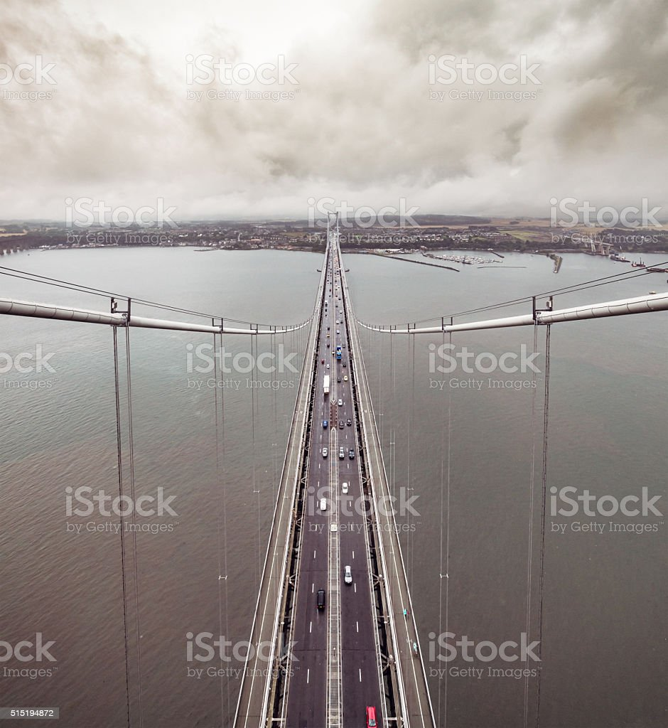 A high angle view of traffic on the Forth Road Bridge over the Firth...