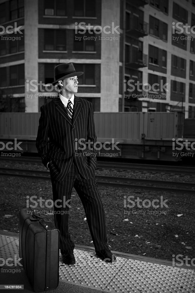 Forties style man waiting for a train royalty-free stock photo