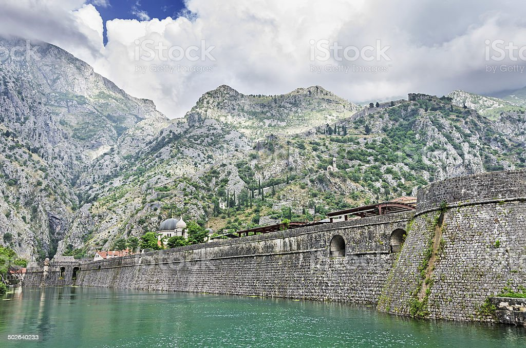 Fortification wall of town Kotor stock photo
