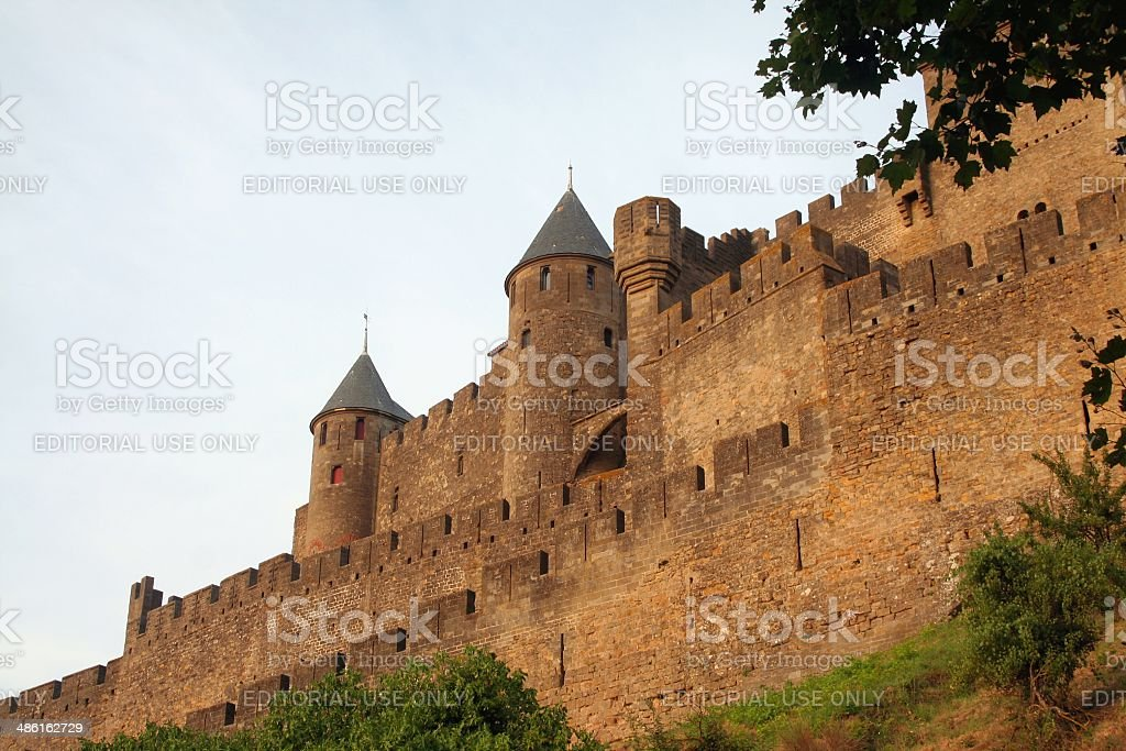 Fortified walls of medieval citadel of Carcassonne at dusk. Languedoc, France. stock photo