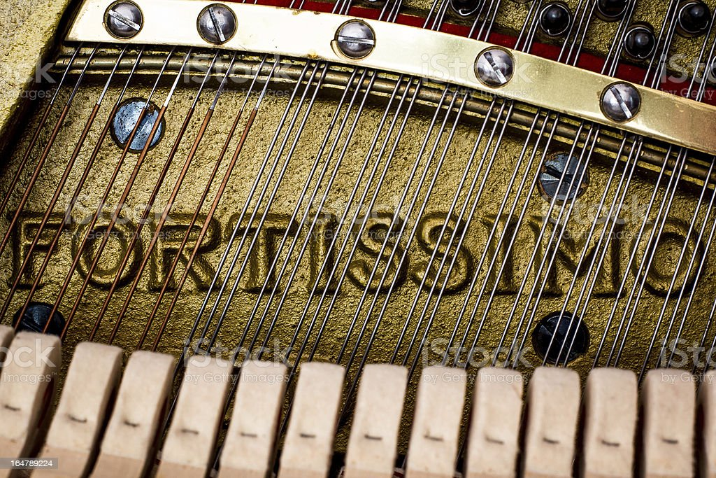 Fortissimo - Close Up Of Piano Strings and Frame stock photo