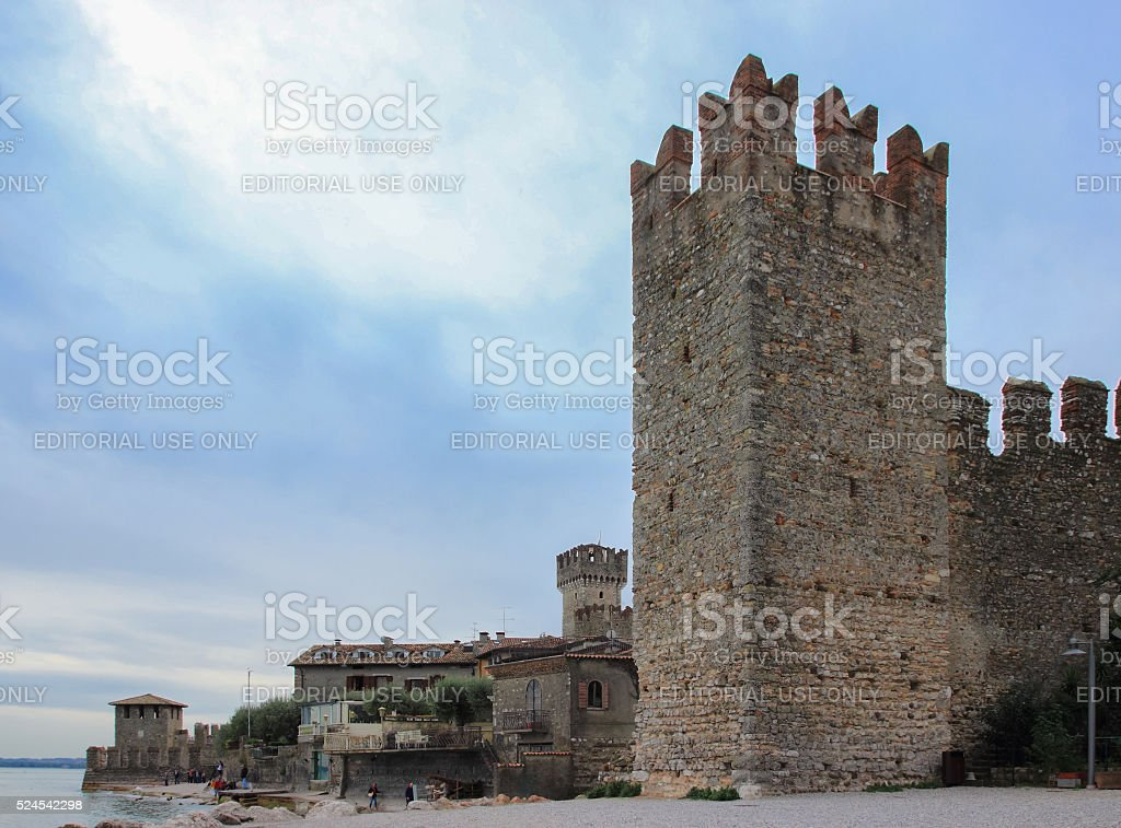 fortress wall with a corner tower of the Scaliger Castle stock photo