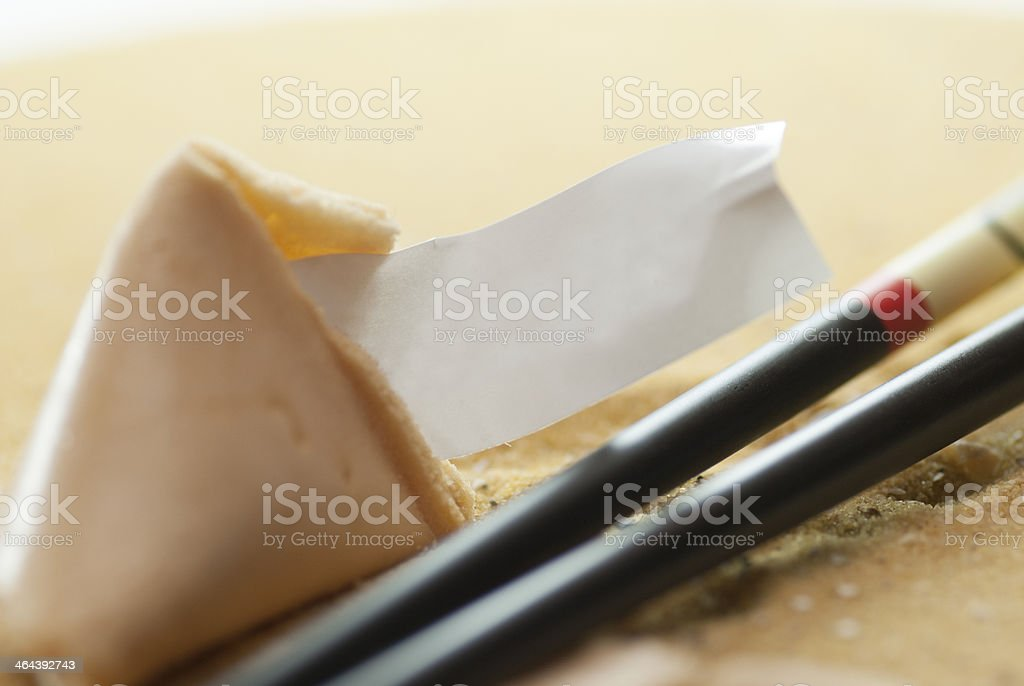 fortune cookie with copyspace on sand royalty-free stock photo