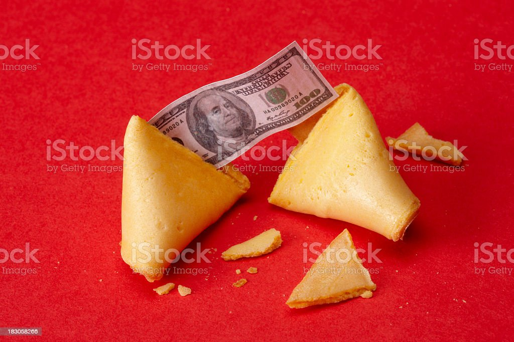 Fortune cookie with money stock photo