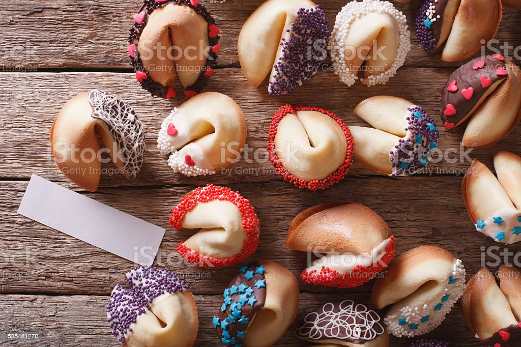 fortune cookies decorated with candy sprinkles closeup. horizontal stock photo
