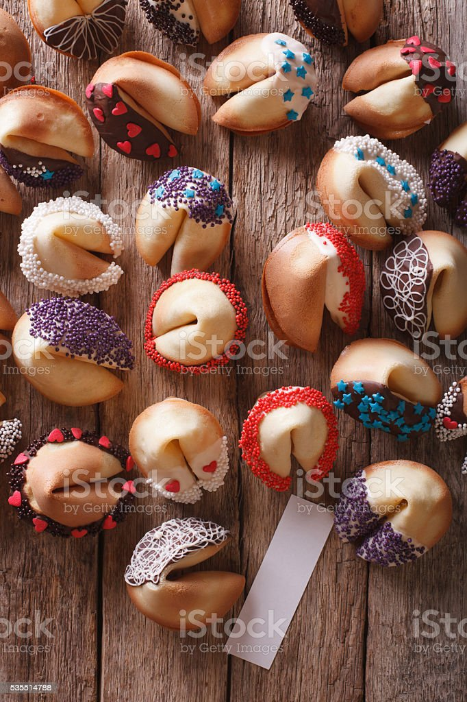 fortune cookies decorated with candy sprinkles closeup. vertical stock photo