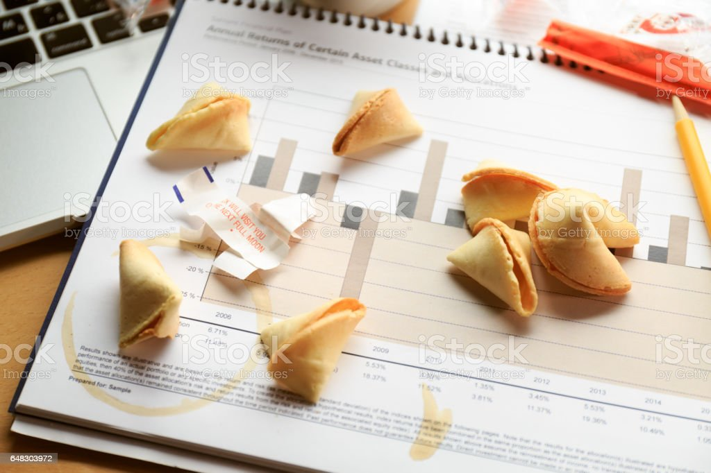 Fortune cookies on a financial chart. Concept of decision making. stock photo