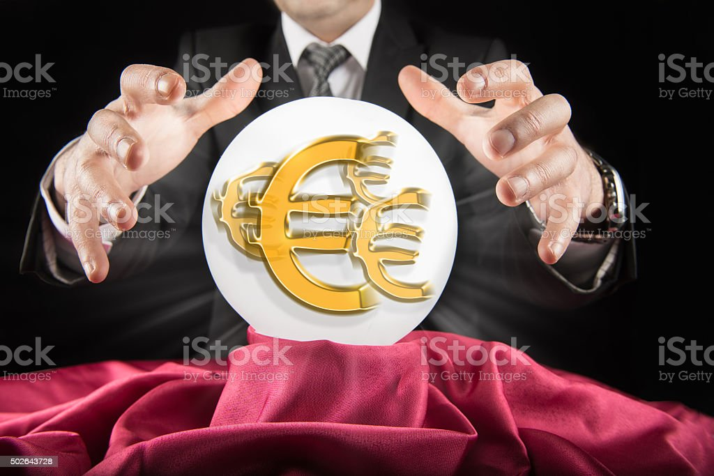 Fortune teller businessman, sees Euro sign in a crystal ball stock photo