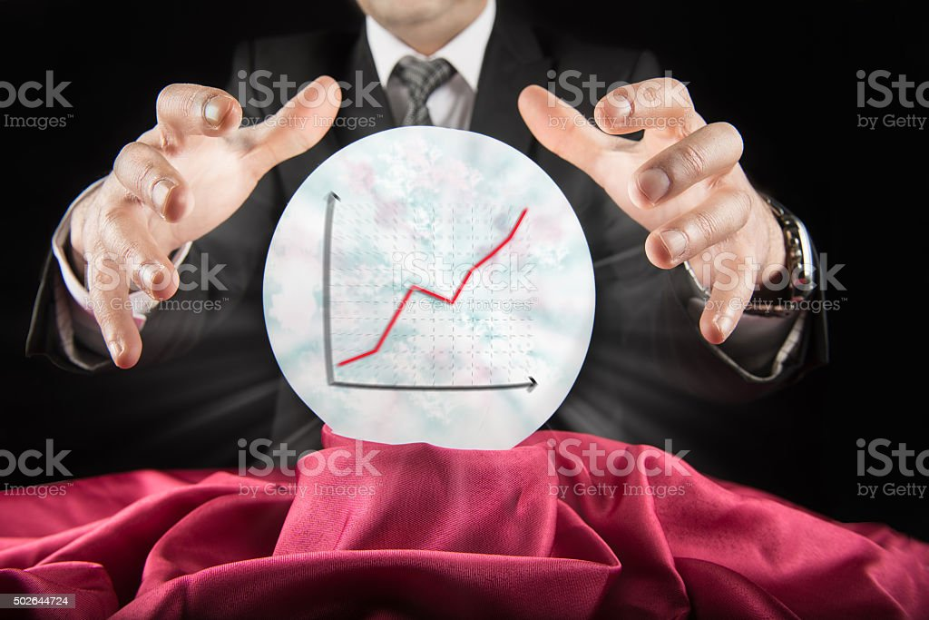 Fortune teller businessman, sees rising graph in a crystal ball stock photo