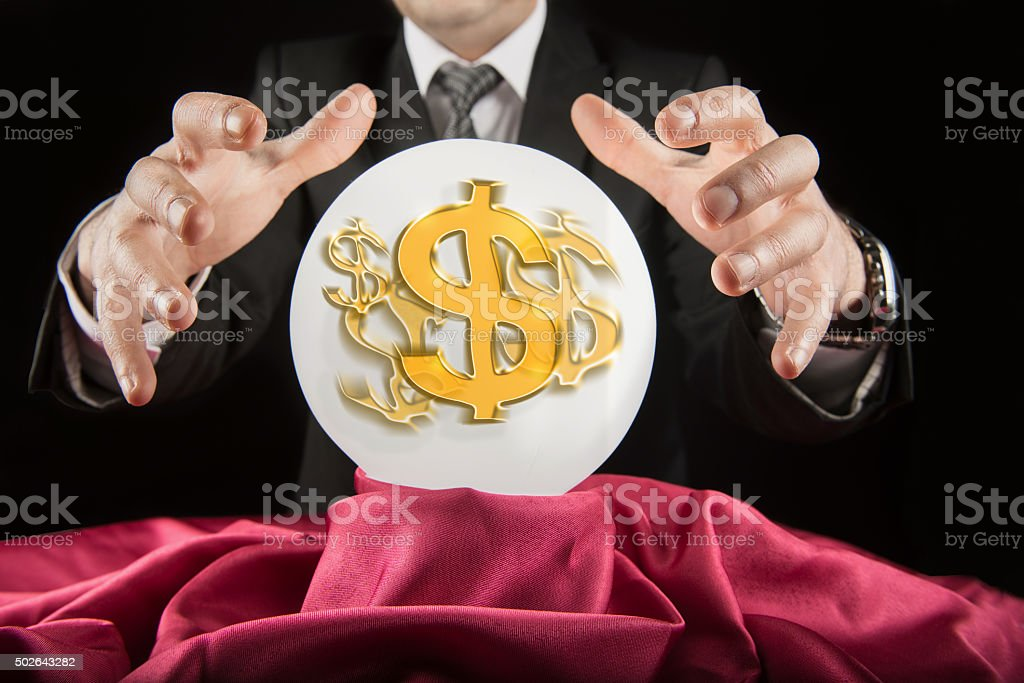 Fortune teller businessman, sees the dollar in a crystal ball stock photo