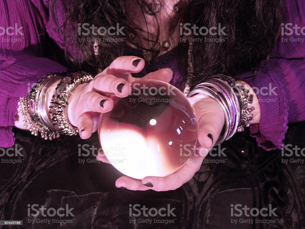 Fortune teller holding a crystal ball stock photo