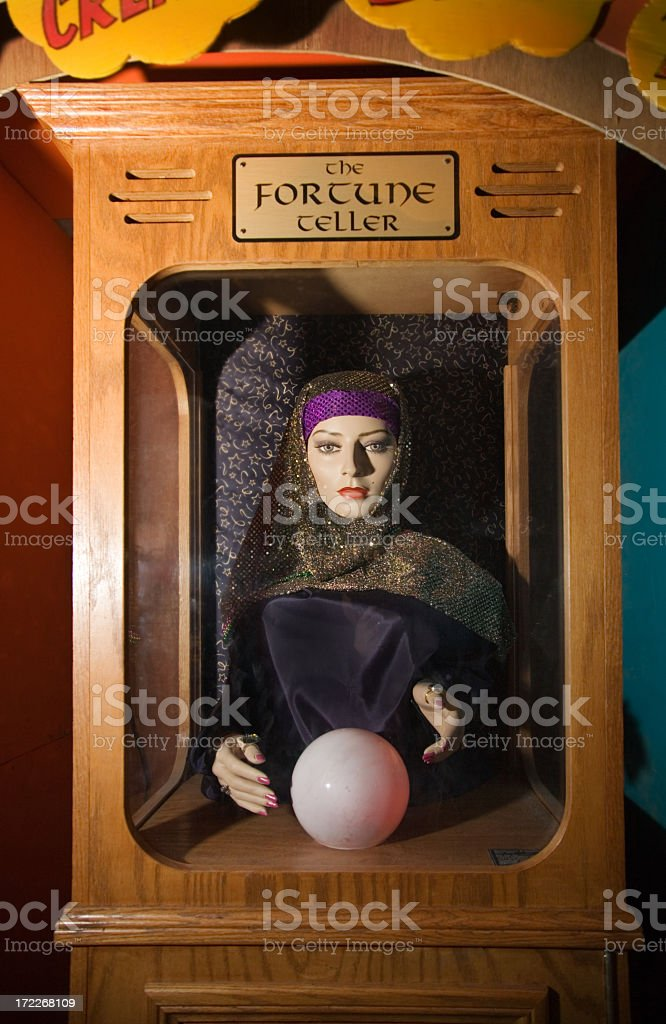 A fortune teller in a wooden box royalty-free stock photo