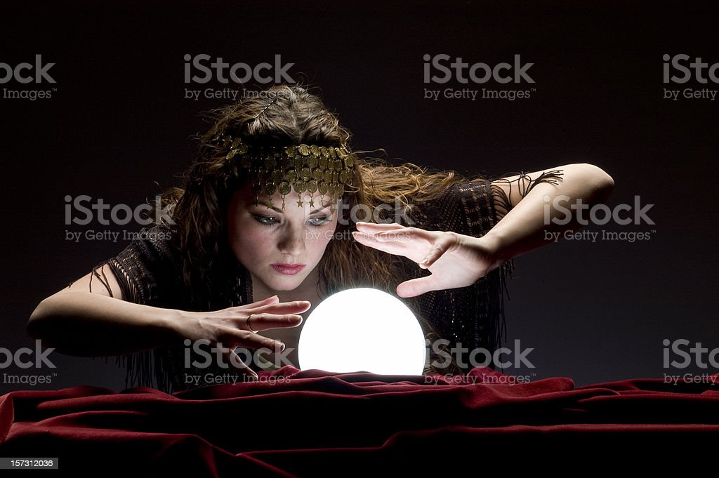 fortune teller looking at crystal ball royalty-free stock photo